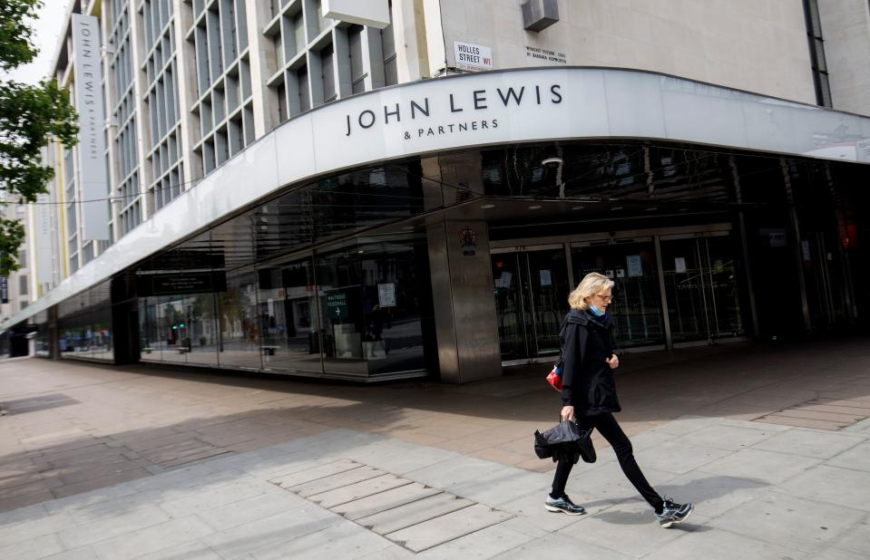 People walk past a John Lewis department store, closed-down due to COVID-19, on Oxford Street in central London on April 27, 2020. - Prime Minister Boris Johnson on Monday made his first public appearance since being hospitalised with coronavirus three weeks ago, saying Britain was beginning to
