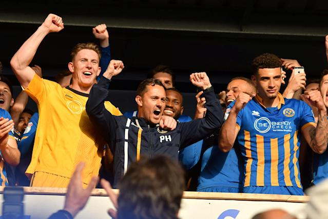 "Soccer Football - League One Play Off Semi Final Second Leg - Shrewsbury Town vs Charlton Athletic - Montgomery Waters Meadow, Shrewsbury, Britain - May 13, 2018 Shrewsbury Town manager Paul Hurst celebrates with players in the Directors' Box after the game Action Images/Paul Burrows EDITORIAL USE ONLY. No use with unauthorized audio, video, data, fixture lists, club/league logos or ""live"" services. Online in-match use limited to 75 images, no video emulation. No use in betting, games or single club/league/player publications. Please contact your account representative for further details."