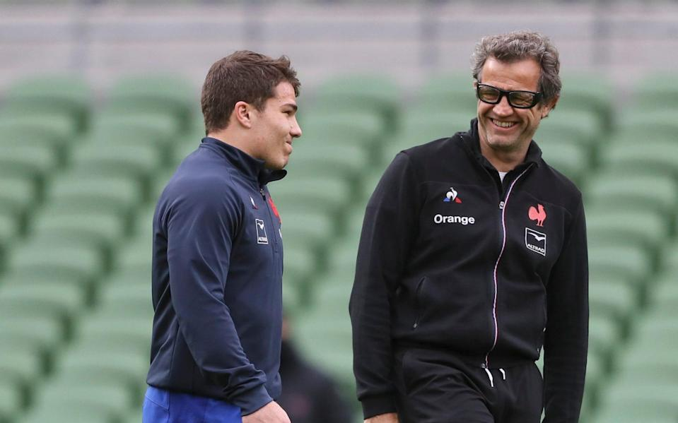star scrum-half Antoine Dupont (left) and head coach Fabien Galthie (right) - France v Scotland decision to be made on Wednesday as Covid outbreak threatens Six Nations match - PA