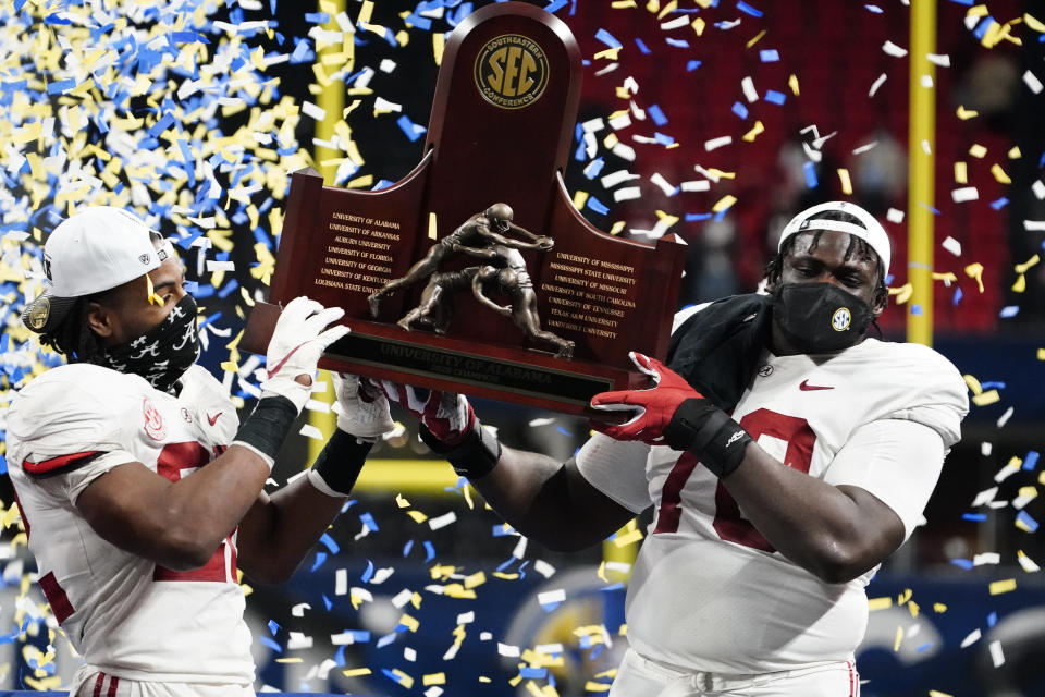 Alabama running back Najee Harris (22) and Alabama offensive lineman Alex Leatherwood (70) celebrates victory against Florida after the Southeastern Conference championship NCAA college football game, Sunday, Dec. 20, 2020, in Atlanta. Alabama won 52-46. (AP Photo/Brynn Anderson)