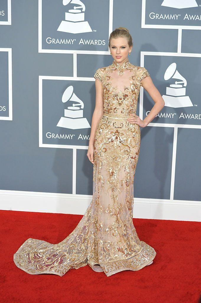 <p>After a year out, Taylor returned to the Grammys with no ringlets, sadly, but a beautiful sheer gold dress with a high neckline by Zuhair Murad Couture instead.</p>