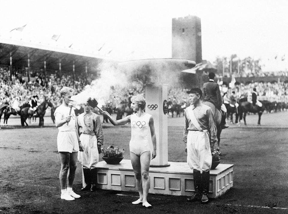 <p>The Olympic torch is lit during the opening ceremony for the 1956 Summer Olympics. Meanwhile, a separate ceremony took place in Stockholm, Sweden. Australia's strict animal quarantine rules made the second location necessary so that equestrian events could be held. </p>