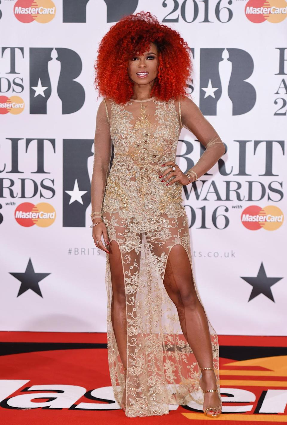 """<p>The """"X Factor"""" star opted for a very revealing number - and a red afro. <i>[Photo: Rex]</i></p>"""