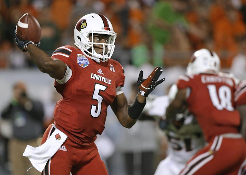 Louisville quarterback Teddy Bridgewater throws a pass against Miami during the first half of the Russell Athletic Bowl NCAA college football game in Orlando, Fla., Saturday, Dec. 28, 2013. (AP Photo/John Raoux)