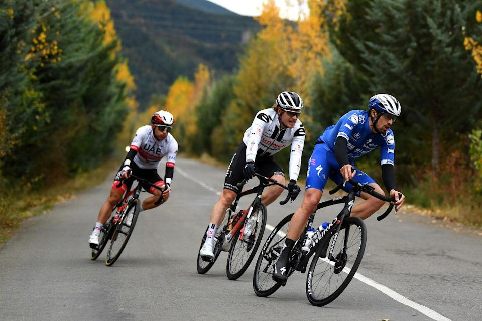 SALLENT DE GLLEGO SPAIN  OCTOBER 25 Mattia Cattaneo of Italy and Team Deceuninck  QuickStep  Jasha Sutterlin of Germany and Team Sunweb  Sergio Henao Montoya of Colombia and UAE Team Emirates  Forest  Autumn  during the 75th Tour of Spain 2020  Stage 6 a 1464km stage from Biescas to Sallent de Gllego  Aramn Formigal 1790m  lavuelta  LaVuelta20  La Vuelta  on October 25 2020 in Sallent de Gllego Spain Photo by David RamosGetty Images