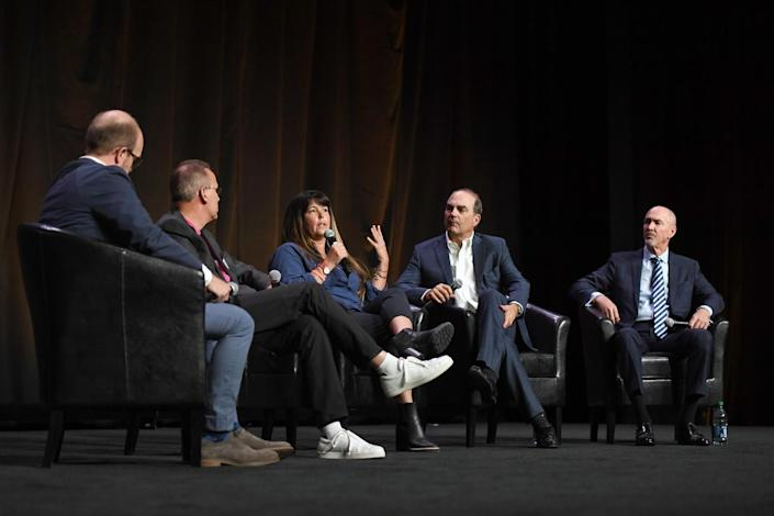 Five people onstage for a panel discussion at CinemaCon.