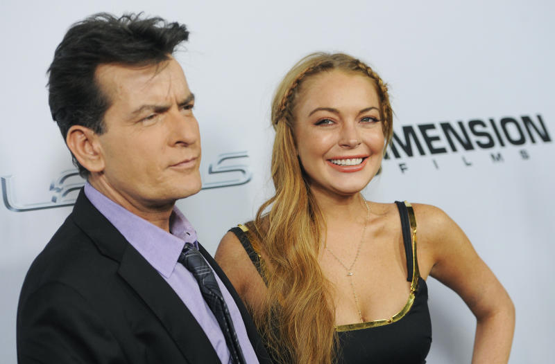 """Charlie Sheen, left, and Lindsay Lohan, cast members in """"Scary Movie V,"""" pose together at the Los Angeles premiere of the film at the Cinerama Dome on Thursday, April 11, 2013 in Los Angeles. (Photo by Chris Pizzello/Invision/AP)"""