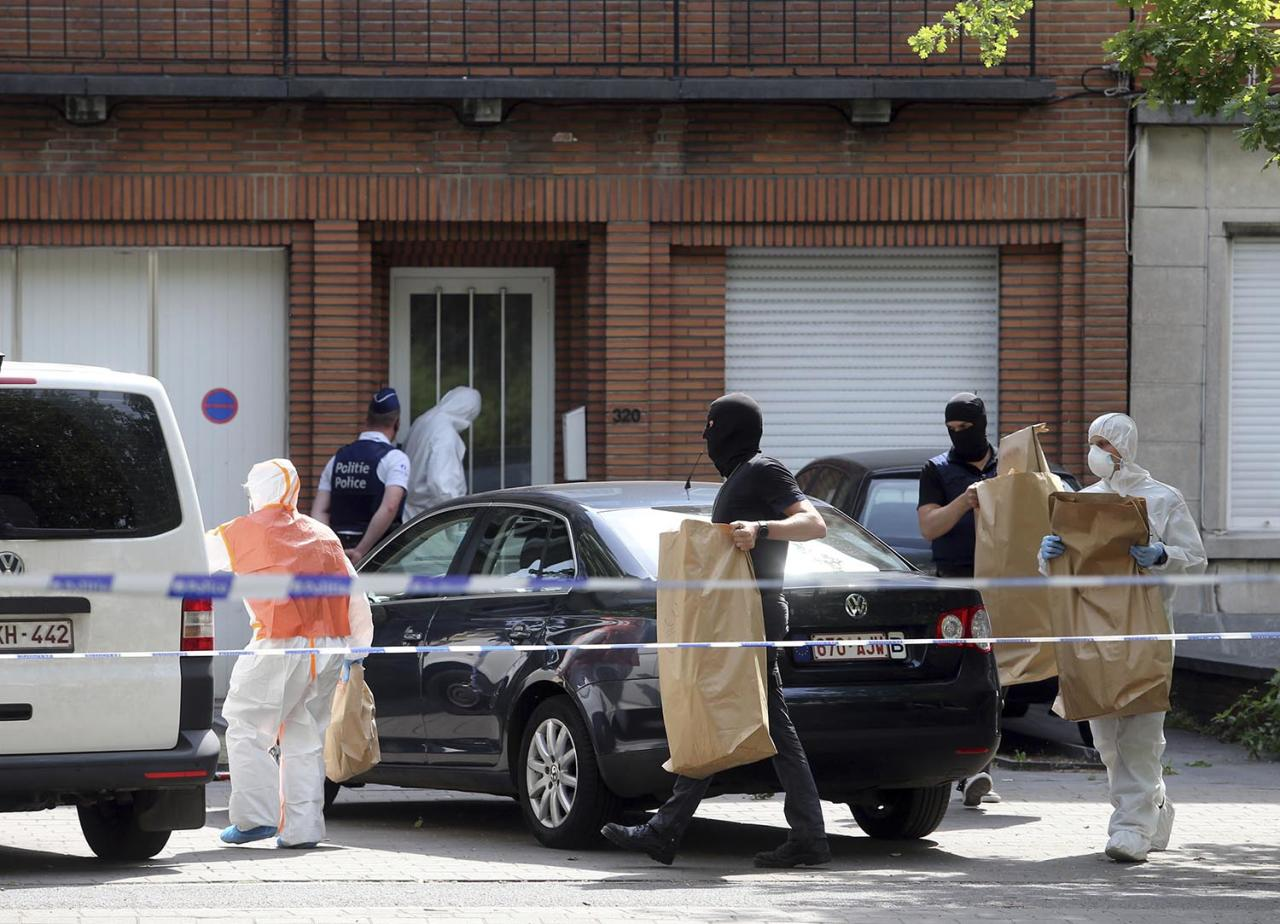 <p>Police and forensic officers remove items during a house search in the Molenbeek district of Brussels on Wednesday, June 21, 2017. (Francois Walschaerts/AP) </p>