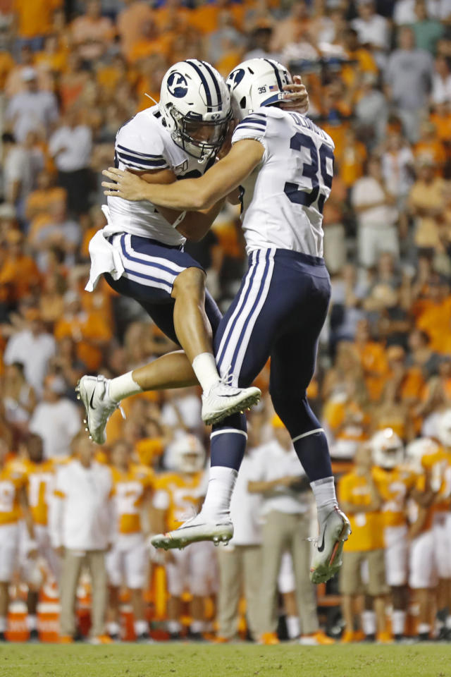 BYU's Jake Oldroyd (39) celebrates a 33-yard field goal with teammate Hayden Livingston in the second half of an NCAA college football game against Tennessee to send the game into overtime Saturday, Sept. 7, 2019, in Knoxville, Tenn. (AP Photo/Wade Payne)