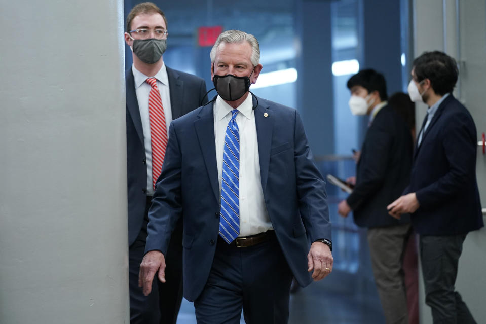 Sen. Tommy Tuberville, R-Ala., walks on Capitol Hill in Washington, Thursday, Feb. 11, 2021, before the start of the third day of the second impeachment trial of former President Donald Trump. (AP Photo/Susan Walsh)