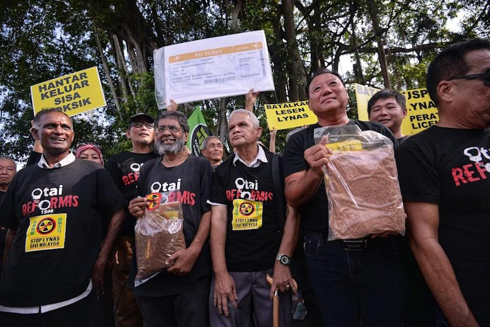 Anti-Lynas demonstrators rally in front of Parliament compound in Kuala Lumpur April 10, 2019. — Picture by Shafwan Zaidon