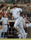 Toronto Blue Jays' Teoscar Hernandez celebrates after hitting a home run against the Atlanta Braves during the seventh inning of a baseball game Wednesday, May 12, 2021, in Atlanta. (AP Photo/Ben Margot)