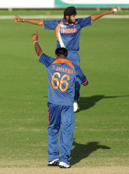 TOWNSVILLE, AUSTRALIA - AUGUST 23:  Sandeep Sharma and Harmeet Singh of India celebrates the wicket of Ish Sodhi of New Zealand during the ICC U19 Cricket World Cup 2012 Semi Final match between India and New Zealand at Tony Ireland Stadium on August 23, 2012 in Townsville, Australia.  (Photo by Ian Hitchcock/Getty Images)