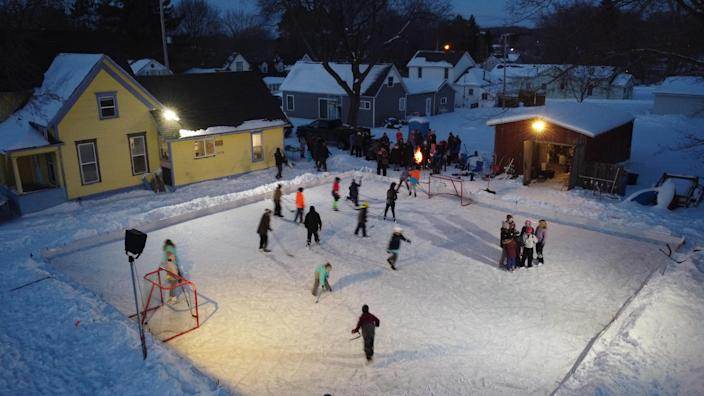 A northern Michigan dad built an ice rink in his backyard from scratch to give the kids in his small town a bit of fun and magic through this dark winter.  / Credit: Handout / Derek Sutton