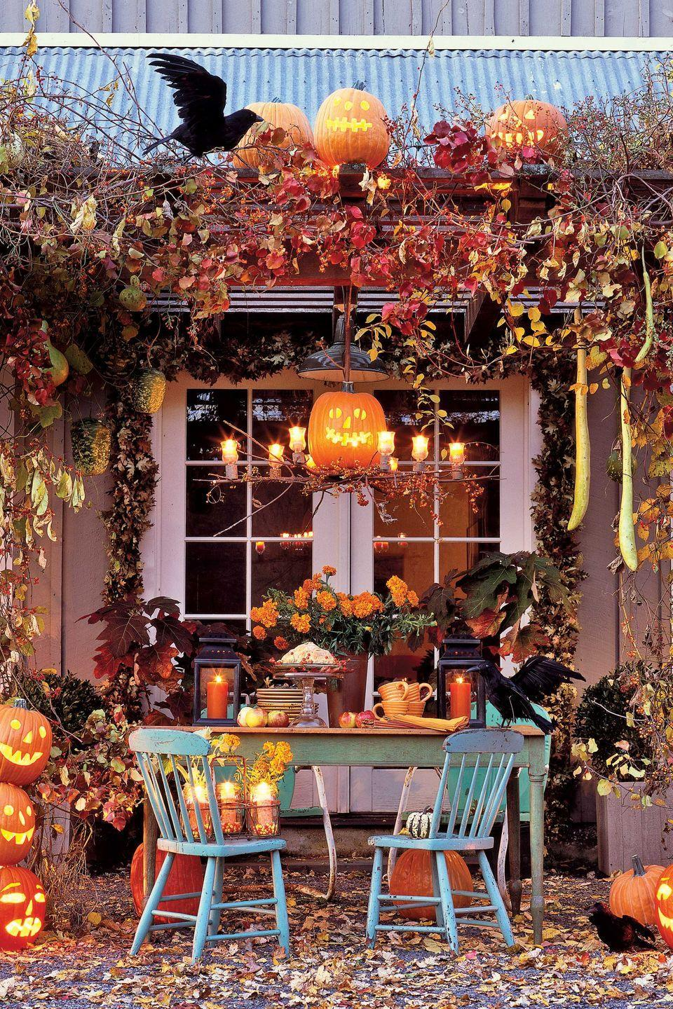 <p>Create a show-stopping Halloween entrance with fall leaves, pumpkins, and faux ravens. </p>