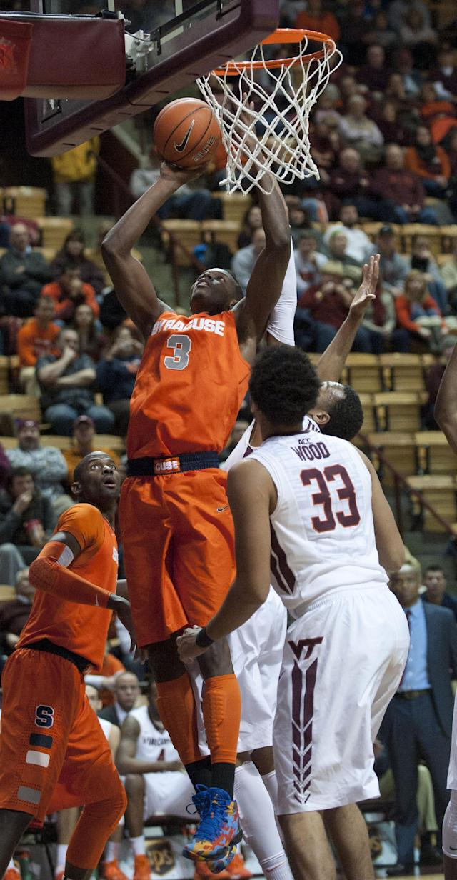 Syracuse's Jerami Grant (3) goes up for a basket in front ofVirginia Tech's Marshall Wood (33) during the first half of an NCAA college basketball game Tuesday, Jan. 7, 2014, in Blacksburg, Va. (AP Photo/Don Petersen)