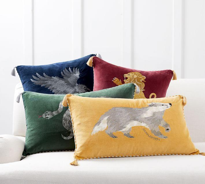 """<p>potterybarn.com</p><p><strong>$29.99</strong></p><p><a href=""""https://go.redirectingat.com?id=74968X1596630&url=https%3A%2F%2Fwww.potterybarn.com%2Fproducts%2Fharry-potter-filled-pillow-cover%2F&sref=https%3A%2F%2Fwww.housebeautiful.com%2Fshopping%2Fg32479102%2Fharry-potter-gifts%2F"""" rel=""""nofollow noopener"""" target=""""_blank"""" data-ylk=""""slk:BUY NOW"""" class=""""link rapid-noclick-resp"""">BUY NOW</a></p><p>Each of these pretty velvet tasseled pillowcases features the symbol of the different Hogwarts houses embroidered on them. </p>"""