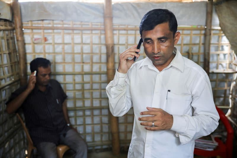 FILE PHOTO: Mohib Ullah, a Rohingya Muslim leader from the Arakan Rohingya Society for Peace and Human Rights, speaks on a phone at his residence in Kutupalong refugee camp in Ukhiya, Cox's Bazar