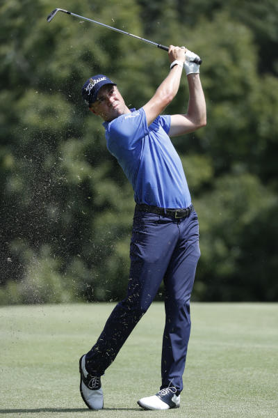 Justin Thomas hits for the fairway on the fifth hole during second round play in the Tour Championship golf tournament Friday, Aug. 23, 2019, at Eastlake Golf Club in Atlanta. (AP Photo/John Bazemore)