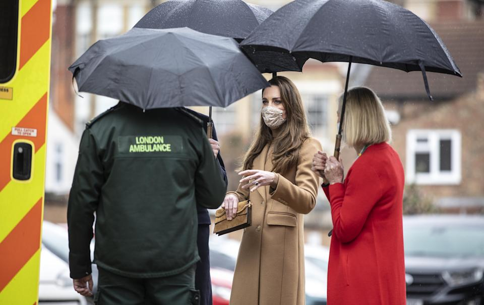The Duchess of Cambridge speaking to staff during a visit to Newham ambulance station. (PA images)