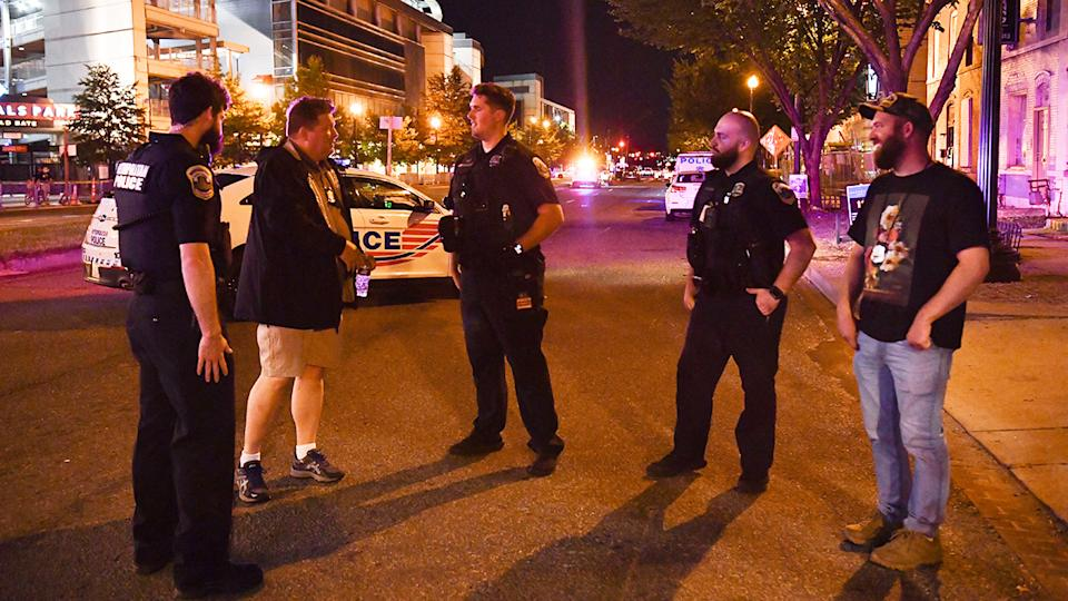 Police officers and detectives, pictured here in a street near Nationals Park.