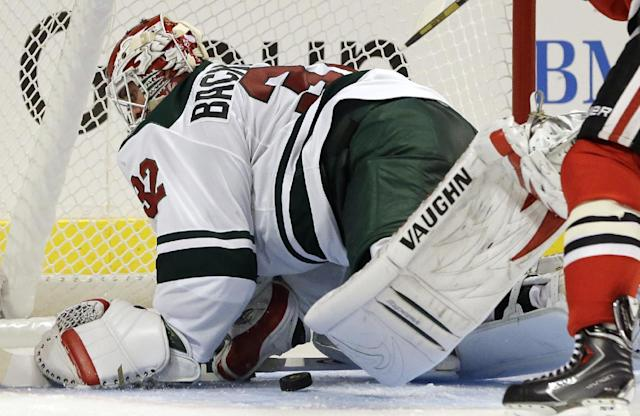 Minnesota Wild goalie Niklas Backstrom (32) saves a shot by Chicago Blackhawks' Patrick Sharp (10) during the second period of an NHL hockey game in Chicago, Saturday, Oct. 26, 2013. (AP Photo/Nam Y. Huh)