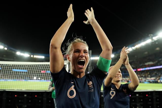 Amandine Henry and Eugenie Le Sommer of France celebrate with the fans following the 2019 FIFA Women's World Cup France group A match between France and Korea Republic at Parc des Princes on June 07, 2019 in Paris, France. (Photo by Richard Heathcote/Getty Images)