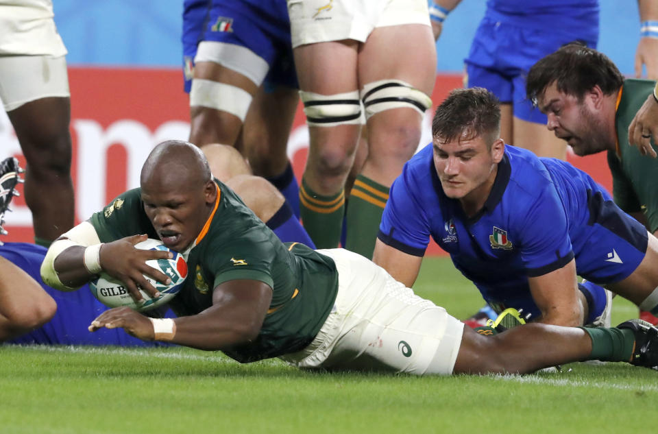South Africa's Mbongeni Mbonambi dives across the line to score a try during the Rugby World Cup Pool B game at Shizuoka Stadium Ecopa between South Africa and Italy, in Shizuoka, Japan, Friday, Oct. 4, 2019. (AP Photo/Shuji Kajiyama)