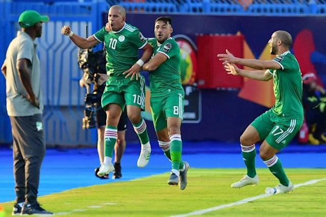 Midfielder Sofiane Feghouli (2nd-L) celebrates scoring for Algeria as Ivory Coast coach Ibrahim Kamara (L) looks on during an Africa Cup of Nations quarter-final in Egypt (AFP Photo/Giuseppe CACACE)