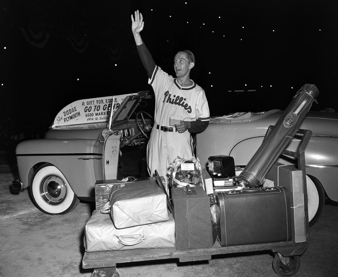 """FILE - In this Aug. 19, 1949 file photo, Philadelphia Phillies first baseman Eddie Waitkus acknowledges the applause of fans at Shibe Park as he stands by gifts showered on him on """"Eddie Waitkus Night"""" in Philadelphia. Waitkus was in uniform for the first time since he was shot, June 14, 1949, in a Chicago hotel by 19-year-old Ruth Steinhagen. Steinhagen died of natural causes at 83 in late December 2012. Her death is the final chapter in one of the most sensational and bizarre criminal cases in Chicago history that made headlines around the country. She was the inspiration for Bernard Malamud's novel """"The Natural"""" and the 1984 movie starring Robert Redford. (AP Photo/File)"""