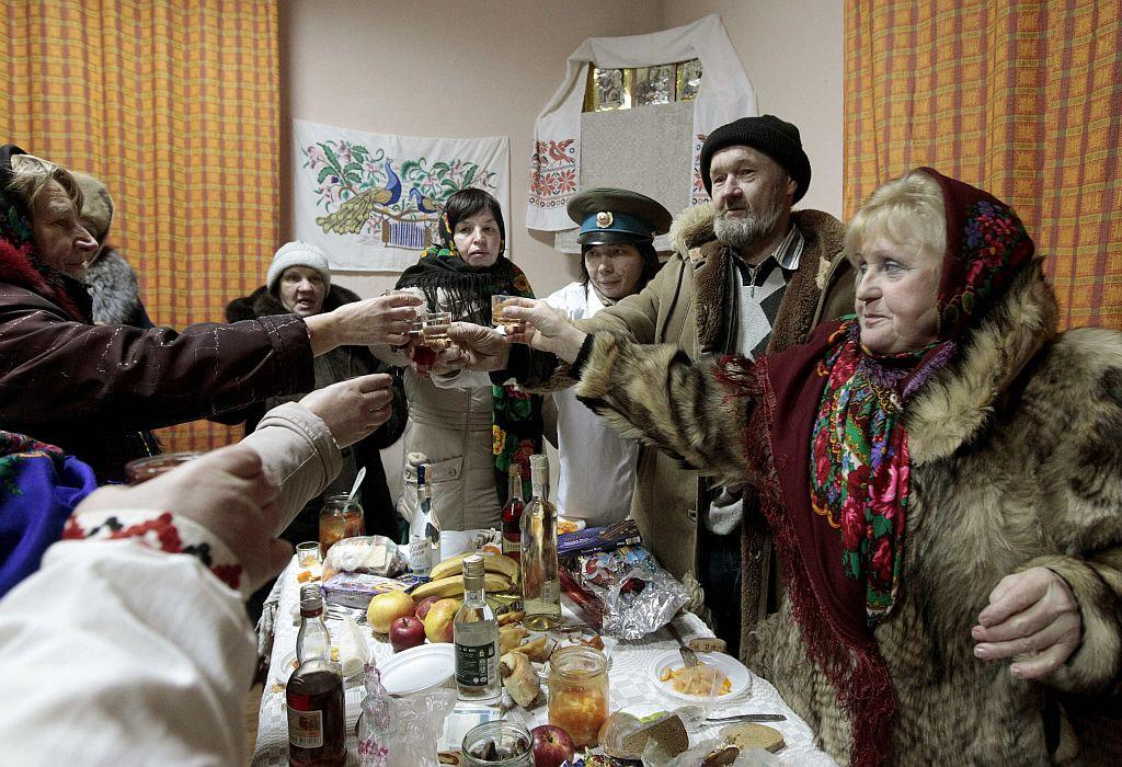 "BELARUS: People celebrate the pagan rite called ""Kolyadki"" in the village of Zhazhelka, some 48 km (30 miles) east of Minsk, January 7, 2013. Kolyada is a pagan winter holiday, which over the centuries has merged with Orthodox Christmas celebrations in Ukraine and some parts of Belarus."