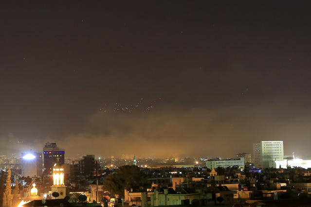 <p>Damascus skies erupt with anti-aircraft fire and smoke as the U.S. launches an attack on Syria targeting different parts of the Syrian capital Damascus, early Saturday, April 14, 2018. (Photo: Hassan Ammar/AP) </p>