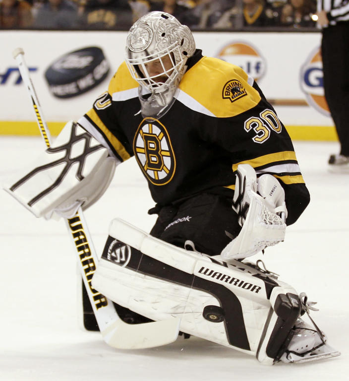 Boston Bruins goalie Tim Thomas makes a save against the Washington Capitals during the first period of Game 5 in a first-round NHL Stanley Cup playoff hockey series in Boston Saturday, April 21, 2012. (AP Photo/Winslow Townson)