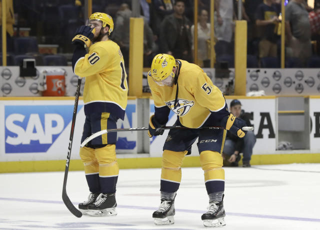 In this Thursday May 10, 2018 photo, Nashville Predators center Colton Sissons (10) and left wing Austin Watson (51) pause on the ice before going to the locker room after losing to the Winnipeg Jets in Game 7 of an NHL hockey second-round playoff series in Nashville, Tenn. The Jets won 5-1 to win the series 4-3. The Predators worked all season long for the right to finish a postseason series on home ice. Yet the best season in franchise history came to an abrupt end because they simply couldn't win in the place called Smashville.(AP Photo/Mark Humphrey)