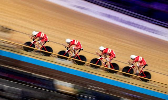 Denmarks team Lasse Norman Hansen Julius Johansen Frederik Rodenberg Madsen and Rasmus Pedersen on their way to set a new world record compete in the Mens Team Pursuit qualifying at the UCI track cycling World Championship in Berlin on February 26 2020 Photo by Odd ANDERSEN AFP Photo by ODD ANDERSENAFP via Getty Images