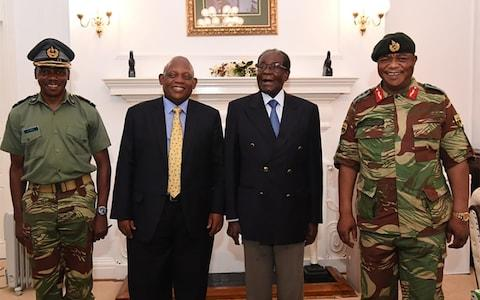 Mr Mugabe met Gen Constantino Chiwenga (R) on Thuesday - Credit: AFP/ZBC