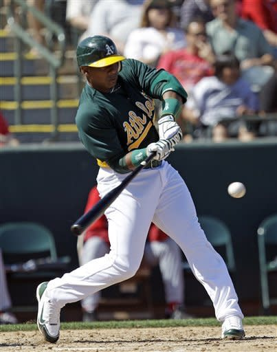 A's Cuban defector Cespedes homers in MLB debut