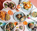 """<p><strong>Give us an overview here.</strong> Citrus Club serves well-curated small plates and fanciful cocktails to adults only (21-and-up). You don't have to be a guest of the club's home at <a href=""""https://www.cntraveler.com/hotels/charleston/the-dewberry?mbid=synd_yahoo_rss"""" rel=""""nofollow noopener"""" target=""""_blank"""" data-ylk=""""slk:The Dewberry Hotel"""" class=""""link rapid-noclick-resp"""">The Dewberry Hotel</a> to access it, but you will need to check in with the concierge by the elevator to receive a temporary keycard granting you access to the sky. The 8th floor elevator door spills you into a pristine white lobby hung with local artist Douglas Balentine's charcoal beach figures. A host leads you to your table. While the indoor space and velvet bar stools are terrifically chic, the outdoor terrace is Citrus Club's calling card. Guests tuck into posh little nooks separated by potted olive trees, lemons, limes, and a smattering of palms. Uninterrupted breezes travel from prevailing corners of a 360-degree view. You can see clear from river to river.</p> <p><strong>How's the crowd?</strong> Citrus Club attracts a well-behaved crowd: tweeds, linens, Gucci loafers. There's a bit of an unspoken dress code (no sweats or yoga pants in sight). Hotel guests take in the view, ladies have post-spa cocktails, and small groups of locals pretend they're on vacation. It's very civilized, not rowdy, which should make the neighbors happy. There's an upbeat affluent resort vibe, an energy, fueled by steady rhythms of techno music. It reminded me a lot of the <a href=""""https://www.cntraveler.com/hotels/puerto-rico/vieques/w-vieques?mbid=synd_yahoo_rss"""" rel=""""nofollow noopener"""" target=""""_blank"""" data-ylk=""""slk:W Resort in Vieques"""" class=""""link rapid-noclick-resp"""">W Resort in Vieques</a>, where musical tracks pursue you in underwater pools.</p> <p><strong>How are the drinks?</strong> While there's a small beer selection, including a refreshing grapefruit radler from Austria, wine and cocktails ar"""