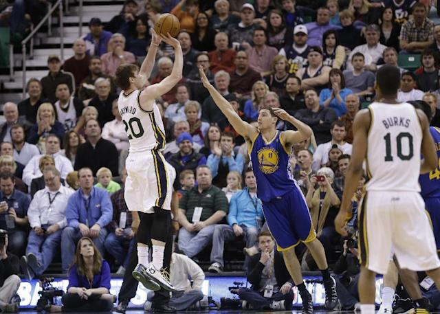 Utah Jazz's Gordon Hayward (20) shoots as Golden State Warriors' Klay Thompson (11) defends in the second quarter of an NBA basketball game Friday, Jan. 31, 2014, in Salt Lake City. (AP Photo/Rick Bowmer)