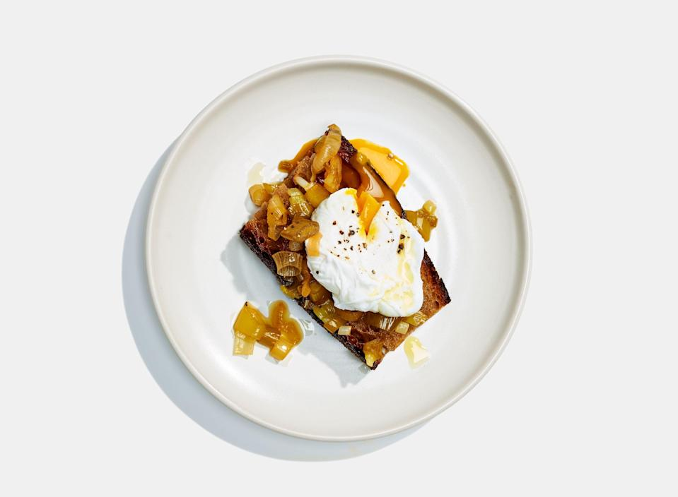 """<a href=""""https://www.bonappetit.com/recipe/toast-with-green-garlic-confit-and-poached-eggs?mbid=synd_yahoo_rss"""" rel=""""nofollow noopener"""" target=""""_blank"""" data-ylk=""""slk:See recipe."""" class=""""link rapid-noclick-resp"""">See recipe.</a>"""
