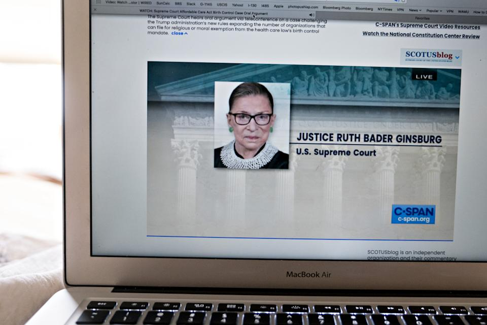 Ruth Bader Ginsburg, associate justice of the U.S. Supreme Court, is displayed on a laptop computer during oral arguments before the Supreme Court in Little Sisters of the Poor v. Pennsylvania in an arranged photograph taken in Arlington, Virginia, U.S., on May 6, 2020.(Andrew Harrer/Bloomberg via Getty Images)