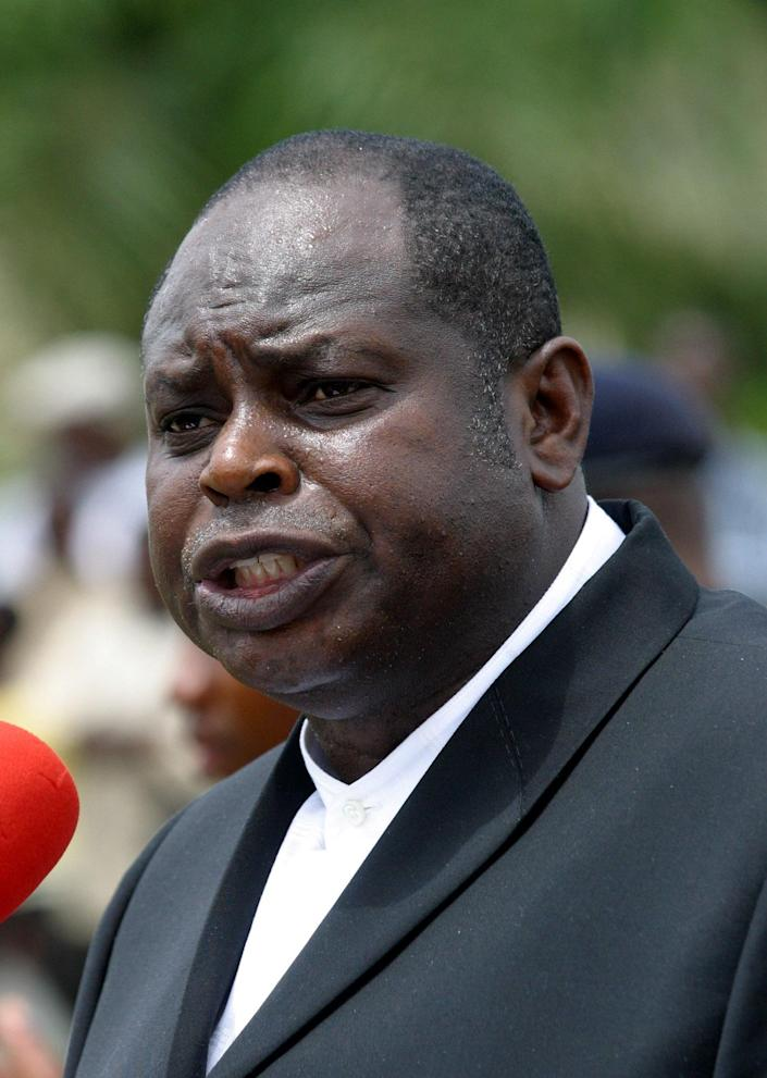 FILE- Diepreye Alamieyeseigha, governor of Bayelsa state, as he makes a speech in Kaiama, in the Niger Delta area of Nigeria in this file photo dated May, 16, 2005. Presidential adviser Doyin Okupe said Wednesday March 13, 2013, that Nigeria's Council of States headed by President Goodluck Jonathan has pardoned the former political benefactor of the nation's president, who was convicted of stealing millions of dollars while serving as a state governor. The decision to pardon Alamieyeseigha was greeted with derision by activists who highlight Nigeria as having one of the world's most corrupt governments. (AP Photo/George Osodi, File)