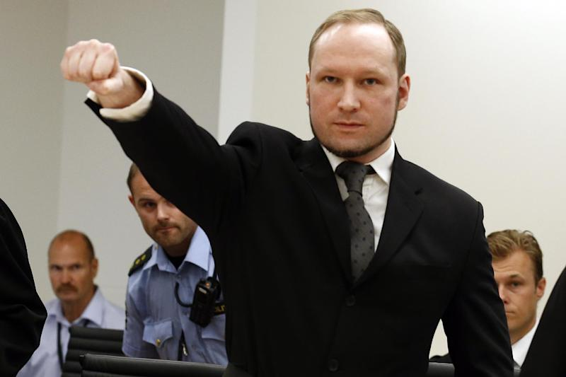 FILE This Friday Aug. 24, 2012 file photo shows mass murderer Anders Behring Breivik, making a salute after his arrival at the court room in Oslo. Breivik, serving a 21-year sentence for killing 77 people, has complained that he is being held in inhumane conditions and is being denied freedom of expression. His lawyer Tord Jordet says Breivik wrote in a letter to prison officials that he has not been given the possibility of expressing political opinions and is not allowed to read every letter addressed to him in the prison. Prison officials were not available for immediate comment Friday Nov. 9, 2012. (AP Photo/Heiko Junge / NTB scanpix, Pool)