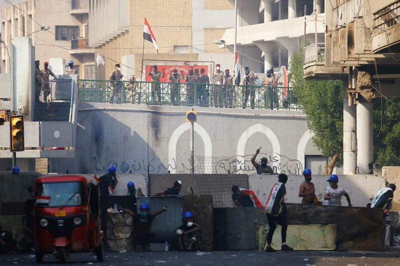 Demonstrators take part during the ongoing anti-government protests in Baghdad