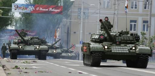 Russian-backed rebels in Donetsk mark the Soviet victory over Nazi Germany in May 1945 with a parade of tanks and other military equipment which is supposedly banned under a series of failed peace accords