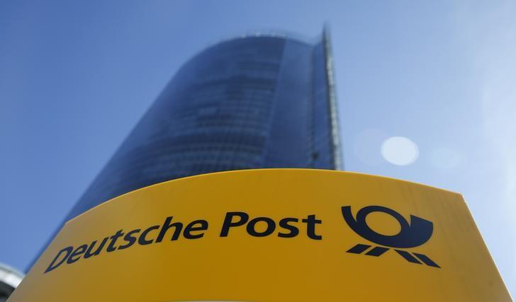 A Deutche Post sign stands in front of the Bonn Post Tower in Bonn