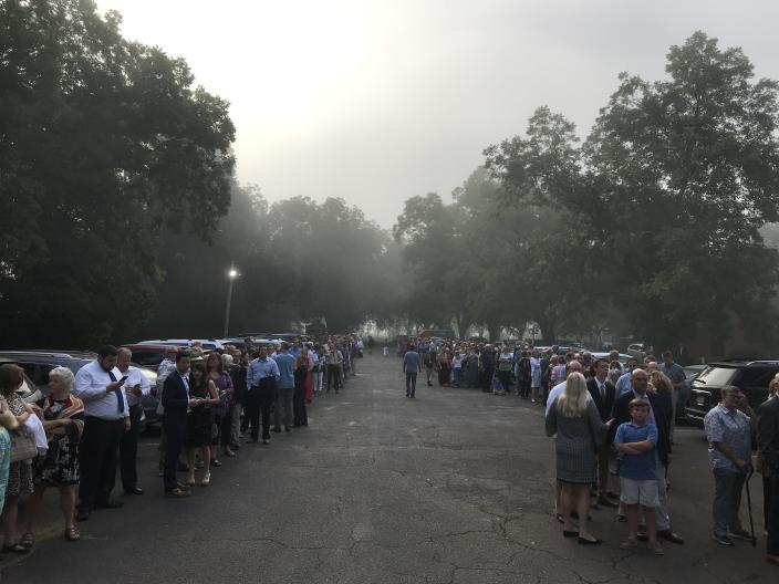 People line up outside Maranatha Baptist Church, in the order they arrived the previous afternoon, into the evening and overnight. Most slept in their cars to see former President Carter teach Sunday school on July 21. Church members worked through the night to keep track of the arrivals and give them line numbers. (Photo: Jon Ward/Yahoo News)