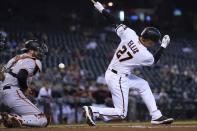 Arizona Diamondbacks' Drew Ellis (27) strikes out as San Francisco Giants catcher Curt Casali, left, blocks the ball from getting past him during the first inning of a baseball game, Thursday, Aug. 5, 2021, in Phoenix. (AP Photo/Ross D. Franklin)