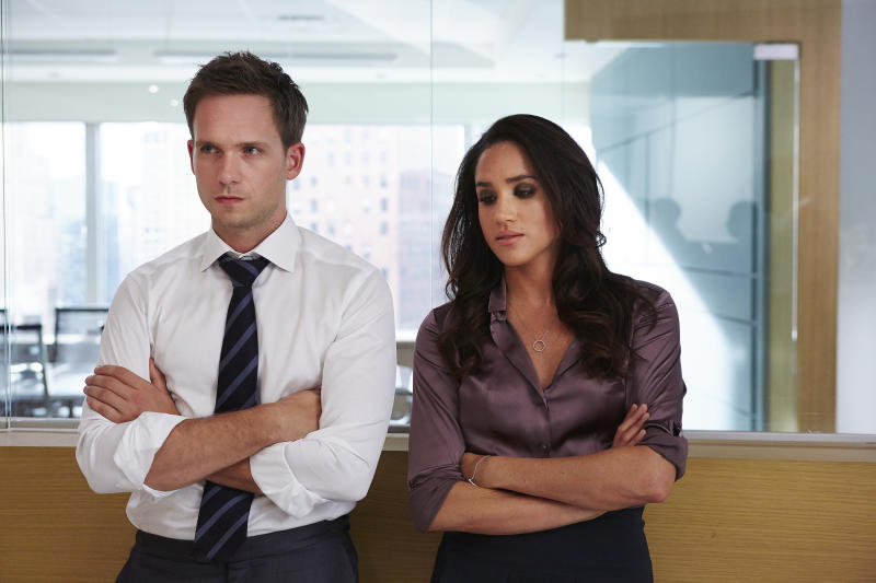 "SUITS -- ""Enough Is Enough"" Episode 411 -- Pictured: (l-r) Patrick J. Adams as Michael Ross, Meghan Markle as Rachel Zane -- (Photo by: Shane Mahood/USA Network/NBCU Photo Bank/NBCUniversal via Getty Images)"