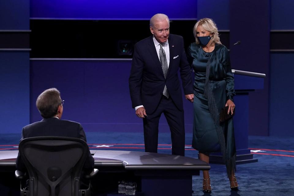 """<p>In what is perhaps Biden's most impactful messaging throughout the course of the 2020 election, <a href=""""https://www.popsugar.com/fashion/jill-biden-dress-presidential-debate-2020-47840642"""" class=""""link rapid-noclick-resp"""" rel=""""nofollow noopener"""" target=""""_blank"""" data-ylk=""""slk:her Gabriela Hearst dress made a statement"""">her Gabriela Hearst dress made a statement</a> at the first presidential debate in September. The label is known for its sustainable practices - the dress just so happens to be green, which makes Jill's point quite literal - and Jill recycled it in her own wardrobe, too, having worn it back in 2017 for a different event. Hearst applauded Dr. Biden for her eco-friendly clothing decision on Instagram following the debate. Now that Hearst has been named new creative director of Chloé, we may see Jill showcase her bohemian side in pieces from that brand, too. Here, she wore Valentino Rockstud heels, a designer It item recognizable to many, which speak to her knowledge of fashion history.</p>"""